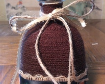 Upcycled Tequila Bottle vase, Hand Decorated with yarn, burlap and pumpkin ribbon