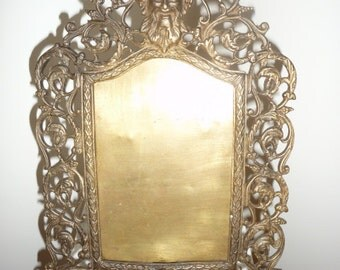 Antique bronze table picture frame with wind God face – circa 1890
