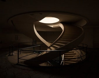 Chiaroscuro photography of a staircase in an abandoned factory in France