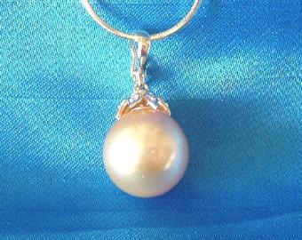 South Sea Golden Pearl, 14kt gold, diamond setting.
