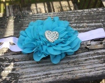 Turquoise Headband. Turquoise Flower Headband. Sparkly Silver Heart Center. 17 Inch Stretchband. Turquoise Headband. Turquoise Flower