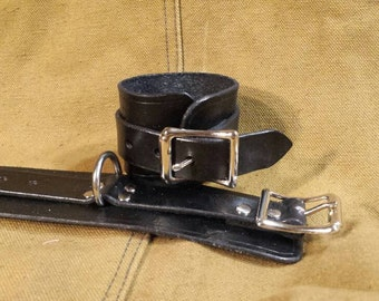 Leather Cuffs one pair.