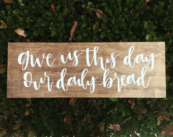 hand lettered calligraphy wood sign // give us this day our daily bread