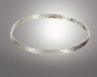 sterling silver bangle decorated with leaf designs