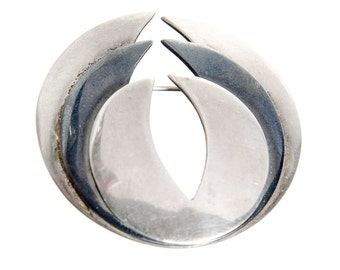 Maricela circular modernist design pin brooch signed