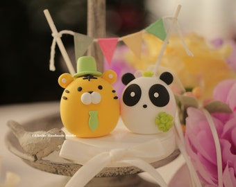 panda and  tiger wedding cake topper