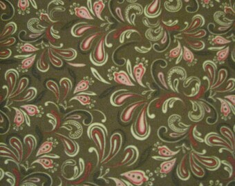 brown background with pink, red, yellow and brown  swirl quilting fabric by the yard