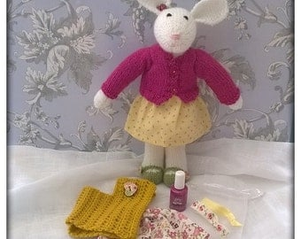 Rose's doudous. Little rabbit and her surprise box. knitted doll
