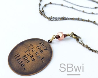Buy the ticket take the ride necklace in bronze with cast copper detail