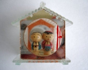 Japanese Kokeshi Dolls In Glass House Miniature Collectible