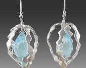 Sterling Silver with Blue Topaz Stones in Orbit 3D Design