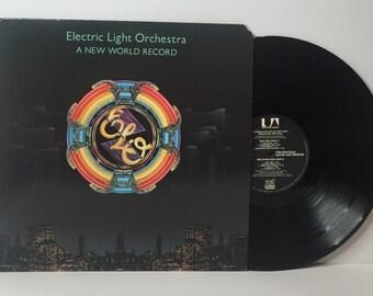 "ELO- A new world record 12"" vinyl record album lp"