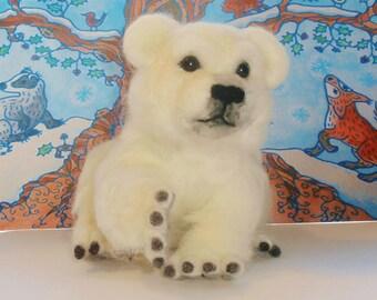Polar bear cub made by needle felting