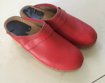 Bright red leather & wood clogs