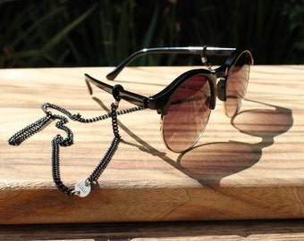 Stefan: Elegant black and silver sunglass and spectacle chain designed by alma chains. #chainyourframes @ www.almachains.com