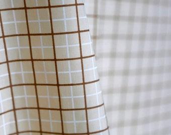 Vintage beige, brown, and white plaid windowpane handprint fabric