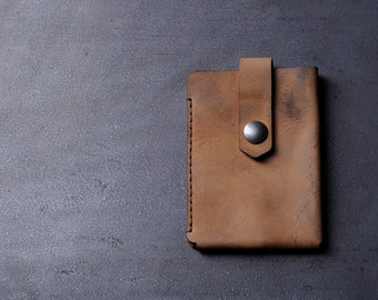 "Front pocket credit or business card holder minimalist style. Genuine ""crazy horse"" leather"