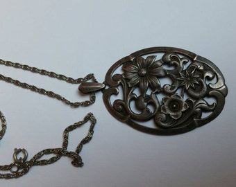 Large floral silver pendant