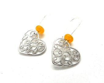 Heart spun yellow beads dangle earrings