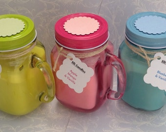 Handmade scented candles in a Mason jar with handle....