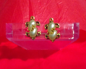 Crescent Styled Pearl Earrings Encased In Gold Wiring