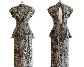 1980s short sleeve cheetah print sheath dress with peplum