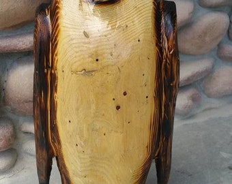 Penguin made from maple tree
