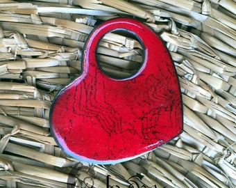 Grabbed heart: enamelled copper red and black brooch