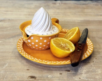 Yellow lemon squeezer with white dots