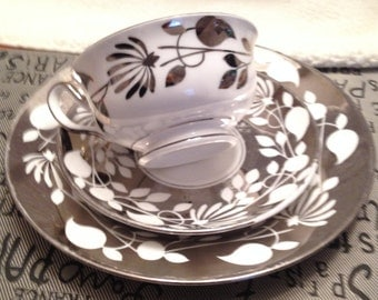 Early mid-century (c.early 1940s) Royal Chelsea   New Chelsea Pottery 2156A silver lusterware trio: cup, saucer and dessert plate.