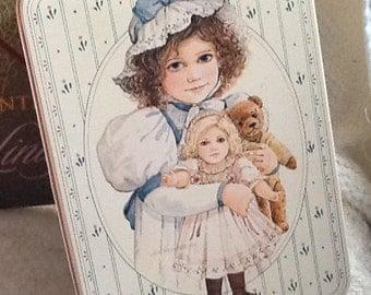 Vintage (c.1984) Sara May by Jan Hagara porcelain doll tin with lid (no doll inside).  Great vintage kitchen or playroom storage.