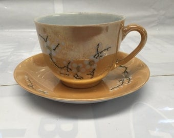 Liling China - White Blossoms on orange Teacup and Saucer Set