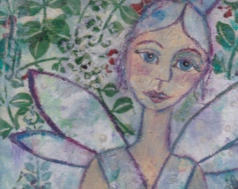 Fairy at the bottom of the garden. A unique mixed media collage art work.
