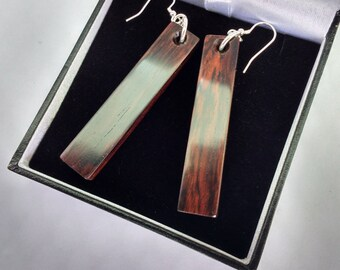 Hand carved Earrings in Rosewood with sterling silver fittings