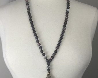 Hand knotted beaded necklace with silver Celtic cross pendant