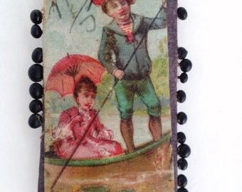 Victorian era antique German sewing pin card with pins, children in boat