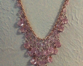 pink glass beads with gold plated chain.