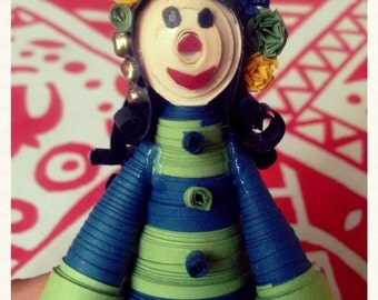 Miniature Quilled Doll with flower-band and beads in her long,curly hair