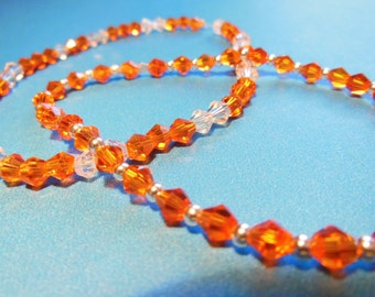 2 Orange swarovski crystal braceltes