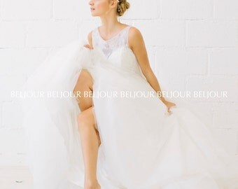 Dramatic Illusion neckline & hand sewn Chantilly lace between two layers of tulle  bridal ball gown