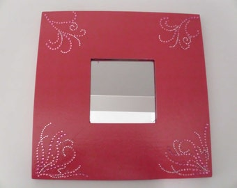 Wood frame mirror in hot pink with rhinestone embellishment