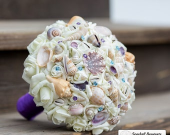 Purple and blue seashell wedding bouquet with seashells, large bridal bouquet shells on silk roses for beach destination weddings