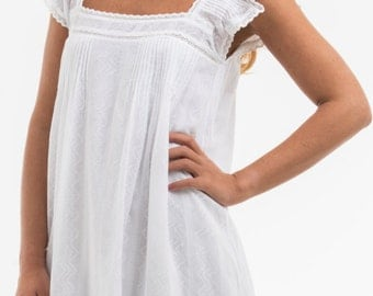 """Dress """"GLORIA"""", 100% cotton embroidered, lace around the neckline and sleeves, small claws in front back and sleeves."""