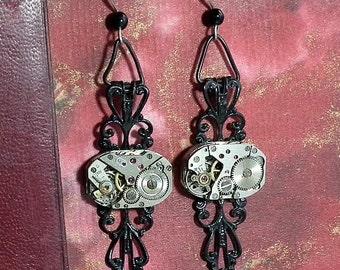 Steampunk Earrings made of  Black filigree with little watch mecanism for pierced or unpierced ears