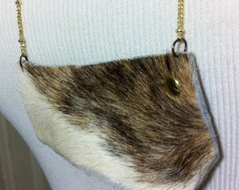 Long bib breastplate cowhide leather necklace w/gold-toned chain.
