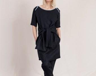 dark blue linen dress with draped belt and cellphone by Natascha von Hirschhausen dark blue organic linen