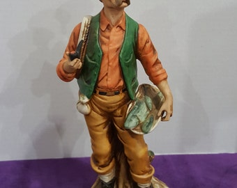 Vintage Capodimonte Porcelain Fisherman with pipe and fish