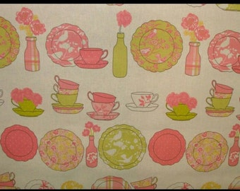 teacups and saucers oilcloth tablecloth in coral