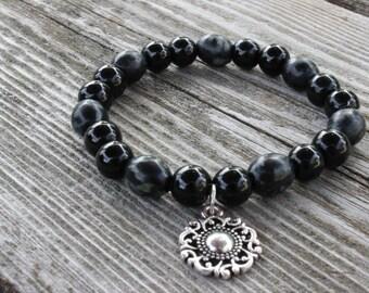 Black glass beaded bracelet with charm