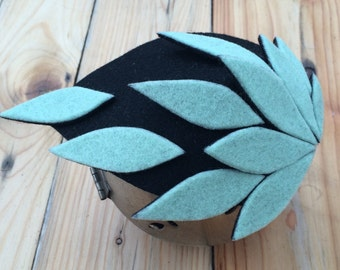 ICE. Pastel blue and black wool felt fascinator / head piece / mini hat